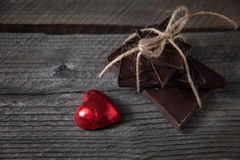 Chocolate with ribbon and heart on St. Valentine`s day love. Stock Photos