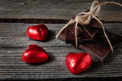 Chocolate with ribbon and heart on St. Valentine`s day love. Royalty Free Stock Images