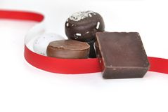 Chocolate in ribbon Royalty Free Stock Photography