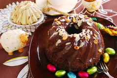 Chocolate ring cake with almonds and nuts topping for easter. Dark chocolate ring cake with almonds and nuts topping for easter Stock Image