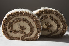 Chocolate roll. Pieces of cake on the table Royalty Free Stock Photography