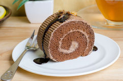 Chocolate roll cake with caramel and chocolate sauce Stock Photography