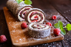 Chocolate roll cake with coconut and raspberry filling. No bake chocolate roll cake filled with coconut cream and raspberry stock image