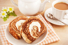 Chocolate roll cake and coffee, filtered image Stock Image