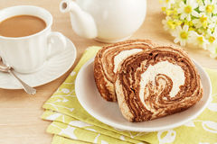 Chocolate roll cake and coffee, filtered image Royalty Free Stock Photography