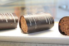Chocolate roll in cake display Royalty Free Stock Image