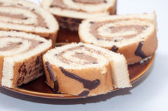 CHOCOLATE ROLL CAKE SLICED ON THE PLATE Royalty Free Stock Photography