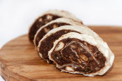Chocolate roll cake on a wooden board Royalty Free Stock Images