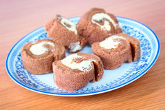 Chocolate roll cakes on plate Royalty Free Stock Images