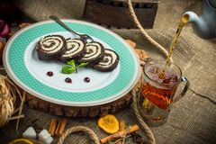 Chocolate roll with coconut filling. Chocolate roll with coconut filling and chocolate sauce stock images