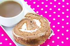 Chocolate roll and coffee cup Stock Photo