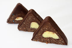 Chocolate roll in the shape of a triangle with a banana in the m Royalty Free Stock Photo
