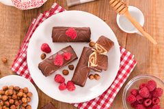 Chocolate rolls with hazelnuts and raspberries. Royalty Free Stock Images