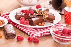Chocolate roll with hazelnuts and strawberries. Stock Photo