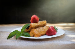 Chocolate rolls with strawberries Royalty Free Stock Images