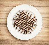 Chocolate rolls on the white plate, confectionery theme Stock Image