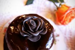 Chocolate rose on a top of cake royalty free stock photography