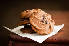 Chocolate Sable Cookies. On parchment paper on wooden table stock photo