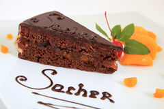 Chocolate sacher cake with decoration Royalty Free Stock Photo