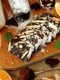 Chocolate salami. Dessert made of biscuits, chocolate and nuts Royalty Free Stock Photos