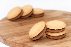 Chocolate sandwich biscuits on the wooden board Stock Images