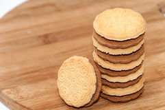 Chocolate sandwich biscuits on the wooden board Stock Photo