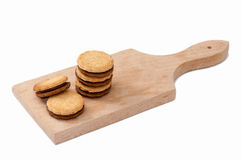 Chocolate sandwich biscuits on the wooden board Royalty Free Stock Photo