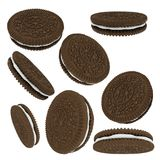 Chocolate sandwich cookies isolated on white background. Sweet product consisting of two chocolate wafers and a sweet creme filling viewed from different Royalty Free Stock Photography