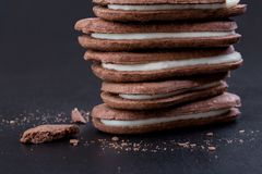 Chocolate sandwich cookies with white cream filling royalty free stock photo