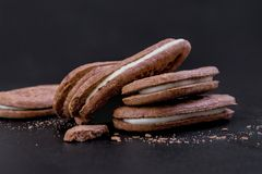 Chocolate sandwich cookies with white cream filling stock images