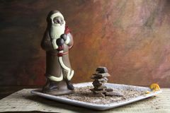 Chocolate Santa Claus and chocolate pieces on plate Stock Images