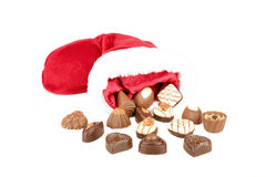 Chocolate and santa hat. On a white background Royalty Free Stock Photos