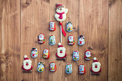 Chocolate Santas, Snowman and Biscuits laying in a form of Chris Royalty Free Stock Image