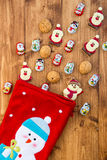 Chocolate Santas, Snowman and Biscuits near Christmas Stocking Stock Image