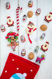 Chocolate Santas, Snowman and Biscuits near Christmas Stocking Stock Photography