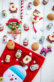 Chocolate Santas, Snowman and Biscuits near Christmas Stocking Stock Images