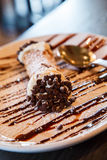 Chocolate Sauce and Chips on Cannoli Stock Images