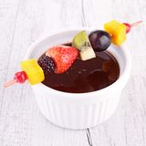 Chocolate sauce and fruits Stock Image