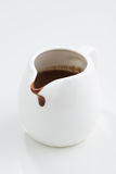 Chocolate sauce in a gravy boat Stock Images
