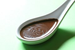 Free Chocolate Sauce On A Porcelain Spoon Stock Photography - 25691682