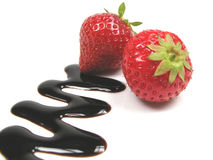 Chocolate sauce and strawberries stock images