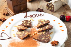 Chocolate sausage with decorations Stock Photo