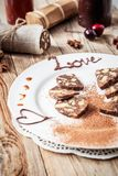 Chocolate sausage on a wooden table Stock Photos