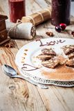 Chocolate sausage on a wooden table Royalty Free Stock Photography