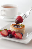 Chocolate scone. A scone filled with chocolate and berries at the side Stock Photo