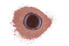 Chocolate seal over cocoa powder Royalty Free Stock Photography