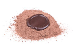 Chocolate seal over cocoa powder Stock Photos