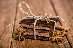 Chocolate set, star anise and cinnamon sticks Stock Images