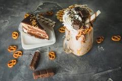 Chocolate shake with milk, dripping sauce, cream and cake. Chocolate shake with milk, dripping sauce, cream stock photography