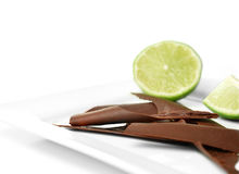 Chocolate Shards & Limes Royalty Free Stock Photography